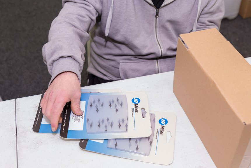 Image of supported worker packing products that have been skin packed